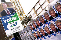 Montreal, November 27th, 2000<br /> A poster in downtown Montreal.(Quebec, CANADA) for Canadian Reform Alliance Progressive Party (CRAPP) leader Stockwell Day encouraging people to vote for his party face a row of posters for Bloc Quebecois leader Gilles Duceppe<br /> Latest polls give about 25 % of the vote to Day and 10 % to Duceppe .