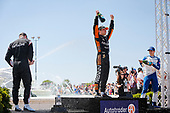 #5: Pato O'Ward, Arrow McLaren SP Chevrolet celebrates winning, #2: Josef Newgarden, Team Penske Chevrolet, #10: Alex Palou, Chip Ganassi Racing Honda, champagne