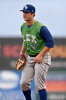 First baseman Joe Dudek (26) of the Lexington Legends plays defense in a game against the Greenville Drive on Friday, June 30, 2017, at Fluor Field at the West End in Greenville, South Carolina. Lexington won, 17-7. (Tom Priddy/Four Seam Images)
