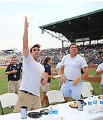 Matt DeMargel throws a hotdog into the crowd after the Bright Leaf Hotdog Eating Conest on Sunday, July , 2011. Photo by Al Drago.