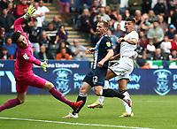 25th September 2021; Swansea.com Stadium, Swansea, Wales; EFL Championship football, Swansea versus Huddersfield; Joel Piroe of Swansea City sees his shot beat Lee Nicholls of Huddersfield Town to score his sides first goal making it 1-0 in the 18th minute