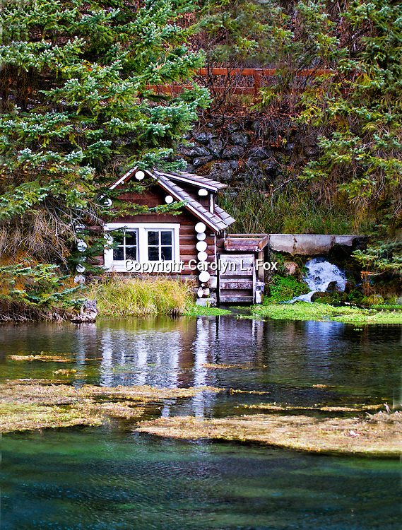 A small pump house sits by the river at Big Spring in Idaho.