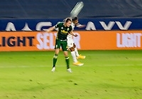 CARSON, CA - OCTOBER 07: Jorge Villafana #4 of the Portland Timbers and Julian Araujo #22 of the Los Angeles Galaxy battle in the air for a ball during a game between Portland Timbers and Los Angeles Galaxy at Dignity Heath Sports Park on October 07, 2020 in Carson, California.