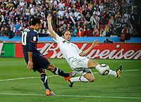 Marko Suler (right) of Slovenia is unable to block the shot of Landon Donovan (right) of USA, 2-1. USA vs Slovenia in the 2010 FIFA World Cup at Ellis Park in Johannesburg, South Africa on June 18th, 2010.