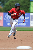 Kody Eaves #21 of the Burlington Bees heads toward third base against the Lansing Lugnuts at Community Field on July 27, 2014 in Burlington, Iowa. The Lugnuts won 3-2.   (Dennis Hubbard/Four Seam Images)