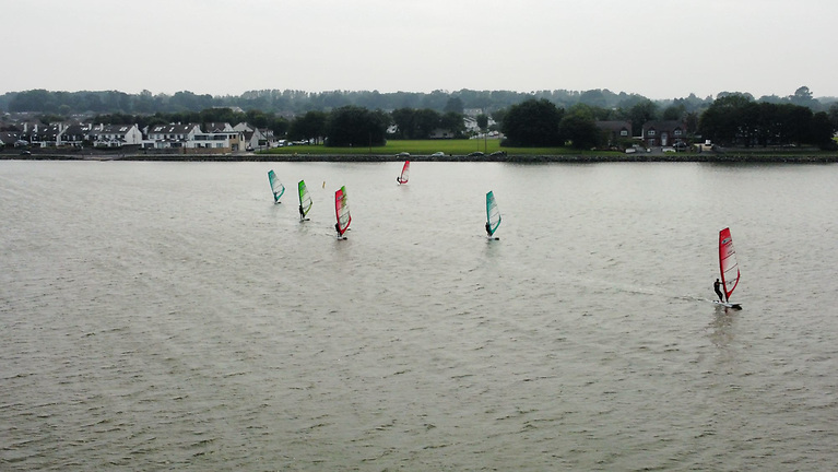 The fleet were challenged with shifty wind conditions at the top mark, close to Malahide village