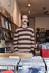 December 17, 2010. Carrboro, NC.. Ethan Clauset, the owner of All Day Records, stands in his store, which sells only vinyl records and turntables. They have been open for just over 2 months.