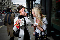 Gemma Darling and Emma Clarke, secretaries at Euroclear in the City of London, share a joke and a packet of crisps. The UK went into recession in the final quarter of 2008 as the City was hit hard by the global credit crunch.
