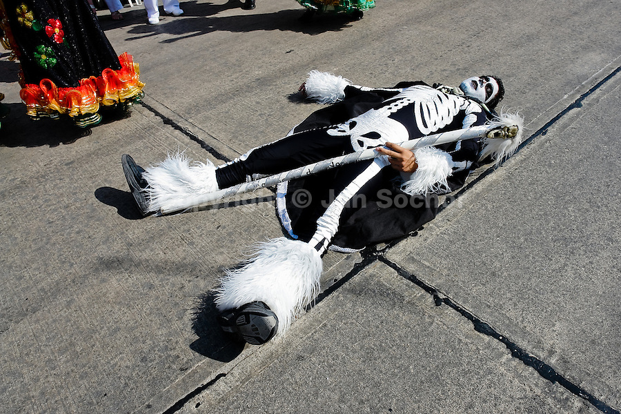 A Colombian man, performing the Death, lies on the floor during the Carnival in Barranquilla, Colombia, 25 February 2006. The Carnival of Barranquilla is a unique festivity which takes place every year during February or March on the Caribbean coast of Colombia. A colourful mixture of the ancient African tribal dances and the Spanish music influence - cumbia, porro, mapale, puya, congo among others - hit for five days nearly all central streets of Barranquilla. Those traditions kept for centuries by Black African slaves have had the great impact on Colombian culture and Colombian society. In November 2003 the Carnival of Barranquilla was proclaimed as the Masterpiece of the Oral and Intangible Heritage of Humanity by UNESCO.