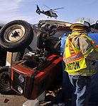 COVINGTON — A farm tractor crash on Klinger Road, north of Covington, claimed on life and sent two other to Dayton-area hospitals aboard CareFlight.<br /> <br /> The crash occurred around 4:30 p.m. when a tractor, pulling a box trailer overturned in the 8000 block of Klinger Road. The tractor pinned the driver and two children underneath. <br /> <br /> Covington Fire and Rescue, along with sheriff's deputies were able to remove the first victim within about 15 minutes and the second a short time later. The third victim, a child, was pinned beneath the tractor and pronounced dead at the scene.<br /> <br /> Two CareFlight helicopters were called to remove the victims for treatment.<br /> <br /> A crash reconstruction team was called in to investigate the crash. No names have been release on any of the victims at this time.<br /> <br /> The crash is being investigated by Miami County sheriff's deputies.