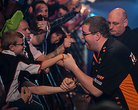 02.01.2015.  London, England.  William Hill PDC World Darts Championship.  Quarter Final Round.  Stephen Bunting (27) [ENG] aiming for consecutive world titles after winning this year's BDO trophy makes his way to the stage before his match against Raymond van Barneveld (14) [NED]