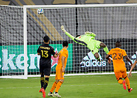 CARSON, CA - OCTOBER 28: Kenneth Vermeer #1 of the Los Angeles FC attempts to clear a ball out of the box during a game between Houston Dynamo and Los Angeles FC at Banc of California Stadium on October 28, 2020 in Carson, California.