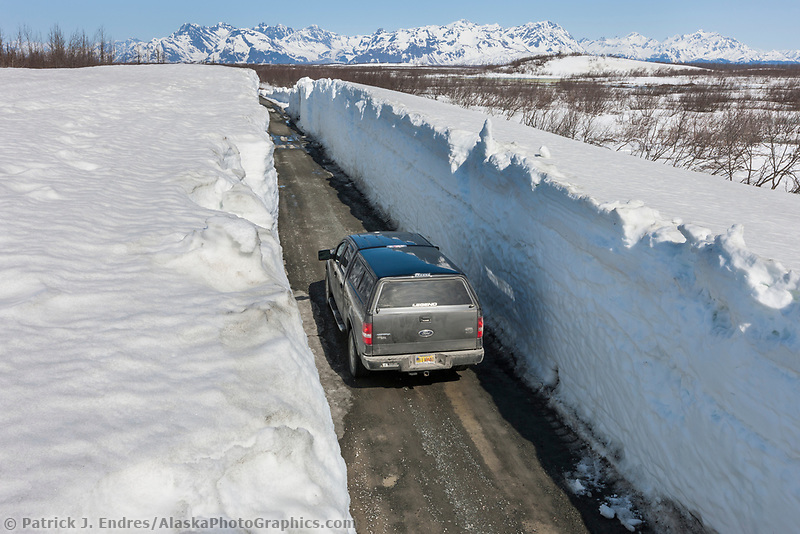 Remnant snow drifts along the Copper river highway that transects the Copper River Delta from Cordova to the Million Dollar Bridge.