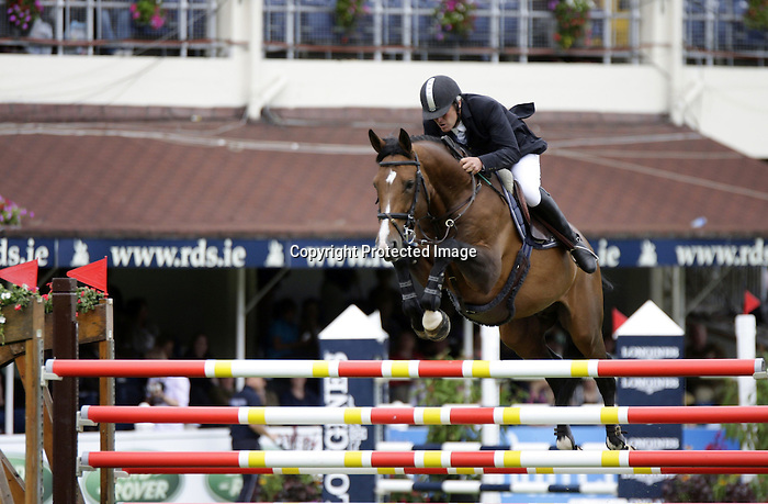 August 09, 2009: Roger Yves Bost (FRA) aboard Ideal De La Loge competing in the Grand Prix event. Longines International Grand Prix. Failte Ireland Horse Show. The RDS, Dublin, Ireland.