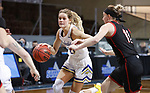 SIOUX FALLS, SD - MARCH 6: Tylee Irwin #21 of the South Dakota State Jackrabbits drives past Claire Killian #11 of the Omaha Mavericks during the Summit League Basketball Tournament at the Sanford Pentagon in Sioux Falls, SD. (Photo by Richard Carlson/Inertia)