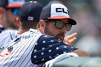 Charlotte Knights pitcher Donny Roach (33) watches the action from the dugout during the game against the Durham Bulls at BB&T BallPark on May 27, 2019 in Charlotte, North Carolina. The Bulls defeated the Knights 10-0. (Brian Westerholt/Four Seam Images)