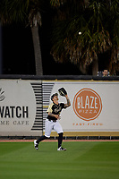 UCF Knights outfielder Jordan Rathbone (34) catches a fly ball during a game against the Siena Saints on February 14, 2020 at John Euliano Park in Orlando, Florida.  UCF defeated Siena 2-1.  (Mike Janes/Four Seam Images)