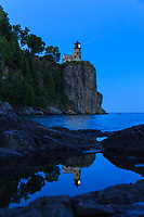"""""""Split Rock's Candle""""<br /> Happy Birthday, Split Rock Lighthouse! On July 31, 1910, the lighthouse beacon first cast its guiding light across Lake Superior. Just a short drive up the shore from Duluth, Minnesota, Split Rock Lighthouse State Park is a favorite destination for many visitors and locals.<br /> <br /> It was a memorable experience witnessing the lighthouse's """"candle"""" being lit on her birthday. Gentle waves lapped at the shore below, complementing the slow rotations of the Fresnel lens. Simply beautiful, elegant tranquility.<br /> <br /> Set atop a 130 foot cliff on Lake Superior, the elevation of the light is 168 feet, and was visible from 25 miles or more. The Fresnel lens is a 2.5-ton, double bull's-eye lens."""