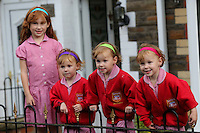 """Pictured L-R: Faye Gilbert with younger triplet sisters Paige, Maddison and Ffion <br /> Re: A set of identical triplets have been colour-coded to help teachers tell them apart on their first day in nursery school.<br /> Three-year-olds Ffion, Maddison and Paige Gilbert, are so alike even their parents struggle to know which is which.<br /> Karen and Ian Gilbert used different coloured nail-varnish on their fingers and toes to identify them when they were babies.<br /> Now the couple are using the same colours for their hair bands and bobbles at the nursery where they have just enrolled.<br /> And the colours even correspond with the names of the identical trio. <br /> Ffion has fuschia, Maddison has mint and Paige has purple.<br /> Karen, 35, of Pontypool, South Wales, said: """"We have colour-coded them since they were tiny babies - it helped us keep track of which ones had been fed.<br /> """"But nail varnish isn't allowed in school so we had come up with come other way."""
