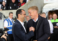 Pictured L-R: Former Swansea team mates, Roberto Martinez manager for Everton and Garry Monk manager for Swansea. Tuesday 23 September 2014<br />