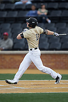 Jonathan Pryor (11) of the Wake Forest Demon Deacons follows through on a 3-run home run against the UNCG Spartans at David F. Couch Ballpark on February 21, 2017 in  Winston-Salem, North Carolina.  The Demon Deacons defeated the Spartans 15-8.  (Brian Westerholt/Four Seam Images)