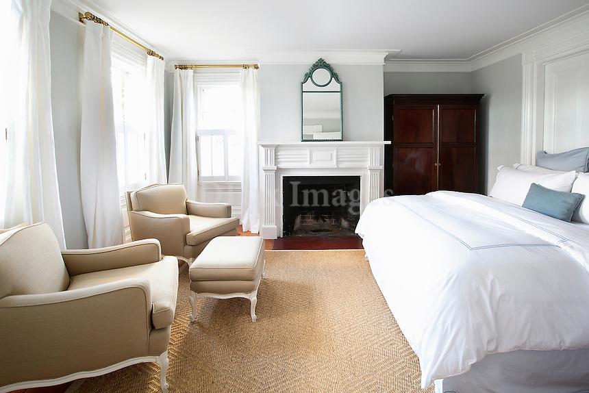 Beige armchairs in the bedroom