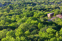 A wet spring leads to lush, green trees at the base of Enchanted Rock's west side.  This photo was taken from above, using a telephoto lens to compress the scale.<br /> <br /> Canon EOS 5D, 70-200 f/2.8L lens