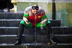 © Joel Goodman - 07973 332324 . 27/12/2017. Wigan, UK. A man dressed as Batman sidekick, Robin, is sick on some steps. Revellers in Wigan enjoy Boxing Day drinks and clubbing in Wigan Wallgate . In recent years a tradition has been established in which people go out wearing fancy-dress costumes on Boxing Day night . Photo credit : Joel Goodman