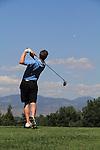 Caucasian man teeing-off at City Park Golf Course, Denver downtown skyline, Denver, Colorado, USA