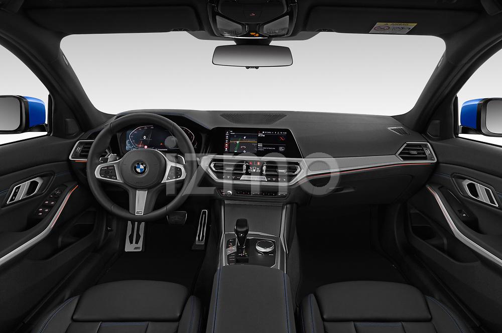 Stock photo of straight dashboard view of 2019 BMW 3-Series M-Sport 4 Door Sedan Dashboard