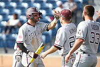 J.B. Moss (11) of the Texas A&M Aggies is greeted by teammates Austin Homan (25) and Ronnie Gideon (33) after scoring during a game against the Pepperdine Waves at Eddy D. Field Stadium on February 26, 2016 in Malibu, California. Pepperdine defeated Texas A&M, 7-5. (Larry Goren/Four Seam Images)