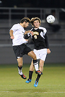 Mark Linnville (26) of the Princeton Tigers and Pete Caringi (9) of the UMBC Retrievers go up for a header. UMBC Retrievers defeated Princeton Tigers 2-1 during the first round of the 2010 NCAA Division 1 Men's Soccer Championship at Roberts Stadium in Princeton, NJ, on November 18, 2010.