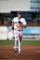 West Michigan Whitecaps first baseman Blaise Salter (24) rounds the bases after Josh Lester (not pictured) hit a home run in the bottom of the second inning during a game against the Clinton LumberKings on May 3, 2017 at Fifth Third Ballpark in Comstock Park, Michigan.  West Michigan defeated Clinton 3-2.  (Mike Janes/Four Seam Images)