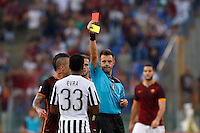 Calcio, Serie A: Roma vs Juventus. Roma, stadio Olimpico, 30 agosto 2015.<br /> Referee Nicola Rizzoli shows a red card to Juventus' Patrice Evra during the Italian Serie A football match between Roma and Juventus at Rome's Olympic stadium, 30 August 2015.<br /> UPDATE IMAGES PRESS/Riccardo De Luca