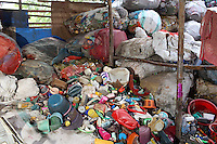 Piles of plastic sit in a informal recycling center in Kolkata.<br /> <br /> To license this image, please contact the National Geographic Creative Collection:<br /> <br /> Image ID: 1925740 <br />  <br /> Email: natgeocreative@ngs.org<br /> <br /> Telephone: 202 857 7537 / Toll Free 800 434 2244<br /> <br /> National Geographic Creative<br /> 1145 17th St NW, Washington DC 20036