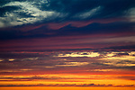 Multicolored Stratocumulus clouds at sunset