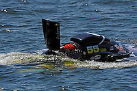 """Frame 5: Jay Gignac, GNH-55 """"Gi Wizz"""" returns to the pits with the left sponson blown out and damage to the right.  (Grand National Hydroplane(s)"""