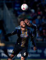 Aurelien Collin (78) of Sporting Kansas City fights for a header with Conor Casey (6) of the Philadelphia Union during a Major League Soccer game at PPL Park in Chester, PA. Sporting Kansas City defeated the Philadelphia Union, 2-1.