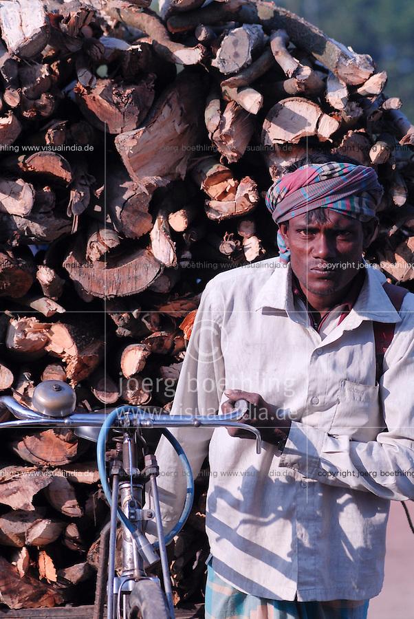 """Asien Suedasien Bangladesh , Rikschakuli transportiert Feuerholz auf einer Rikscha  -  Brennholz xagndaz   .South asia Bangladesh , Kuli transport firewodds by cycle rikshaw - fuel .  [ copyright (c) Joerg Boethling / agenda , Veroeffentlichung nur gegen Honorar und Belegexemplar an / publication only with royalties and copy to:  agenda PG   Rothestr. 66   Germany D-22765 Hamburg   ph. ++49 40 391 907 14   e-mail: boethling@agenda-fototext.de   www.agenda-fototext.de   Bank: Hamburger Sparkasse  BLZ 200 505 50  Kto. 1281 120 178   IBAN: DE96 2005 0550 1281 1201 78   BIC: """"HASPDEHH"""" ,  WEITERE MOTIVE ZU DIESEM THEMA SIND VORHANDEN!! MORE PICTURES ON THIS SUBJECT AVAILABLE!!  ] [#0,26,121#]"""