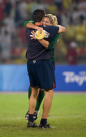 USWNT goalkeeper Hope Solo celebrates with coach Phil Wheddon after playing for the gold medal at Workers' Stadium.  The USWNT defeated Brazil, 1-0, during the 2008 Beijing Olympics women's soccer final in Beijing, China.