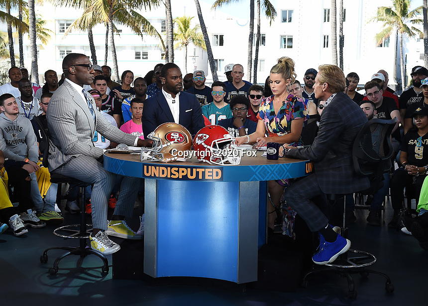"""MIAMI BEACH, FL - JANUARY 29: Shannon Sharpe, Michael Vick, Jenny Taft, and Skip Bayless on the set of """"Skip & Shannon: Undisputed"""" on the Fox Sports South Beach studio during Super Bowl LIV week on January 29, 2020 in Miami Beach, Florida. (Photo by Frank Micelotta/Fox Sports/PictureGroup)"""
