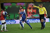 BOGOTA - COLOMBIA, 11-04-2021: Jhon Ospina, arbitro señala falta en el area, durante partido de la fecha 18 entre Independiente Santa Fe y Millonarios F. C. por la Liga BetPlay DIMAYOR I 2021, en el estadio Nemesio Camacho El Campin de la ciudad de Bogota. / Jhon Ospina, referee signals penalty fault during a match of the 18th date between Independiente Santa Fe and Millonarios F. C., for the BetPlay DIMAYOR I 2021 League at the Nemesio Camacho El Campin Stadium in Bogota city. / Photo: VizzorImage / Luis Ramirez / Staff.