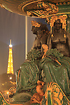 A closed up of night view of Fountain of River Commerce and Navigation in Place de la Concorde with Eiffel Tower in the background. Paris. France