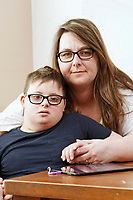 Pictured: Victoria Baynham (R) with son Alex Jones. Friday 02 February 2018<br /> Re: 12 year old Alex Jones, who has Down's Syndrome, was not dropped off home by bus company CJ Contract Travel Services but instead was discovered at the company's depot in Barry, south Wales, on his way back from Ysgol Y Deri School in nearby Penarth.