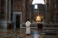 A priest stands by Michelangelo's Pieta while visiting St. Peter's Basilica as it reopens on May 18, 2020 at the Vatican. Italy is slowly lifting sanitary restrictions after a two-month coronavirus lockdown.<br /> UPDATE IMAGES PRESS/Isabella Bonotto<br /> <br /> STRICTLY ONLY FOR EDITORIAL USE