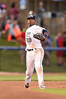 West Michigan Whitecaps third baseman Francisco Contreras (29) throws to first during a game against the Great Lakes Loons on June 5, 2014 at Fifth Third Ballpark in Comstock Park, Michigan.  West Michigan defeated Great Lakes 6-2.  (Mike Janes/Four Seam Images)