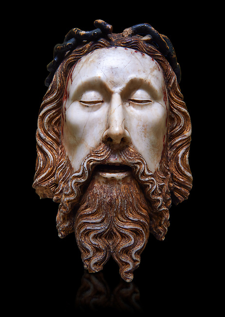 Gothic statue of the Head of Christ by  Jaume Cascalls. Carved alabaster with polychrome and gilt remains.  This head must have belonged to a Recumbent Christ which could have formed part of a sculptural group of the Holy Sepulchre. It probably came from the chapel of Corpus Christi of the convent of Sant Agustí Vell, Barcelona.<br /> Jaume Cascalls is one of the most important sculptors of the fourteenth century in Catalonia. This is borne out by his involvement over almost thirty years with the project of the royal pantheon in Poblet for King Peter the Ceremonious and with other large undertakings of the time. Today, on stylistic grounds, he is credited with this 'Head of Christ', which must have formed part of a sculptural group of the Holy Sepulchre, presumably from the church of the convent of Sant Agustí Vell in Barcelona. The break in the neck suggests it belonged to a full-length recumbent Christ, like the one kept at Sant Feliu in Girona and also attributed to Cascalls. National Museum of Catalan Art, inv no: 034879-000