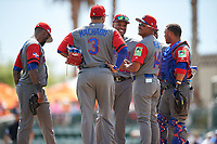 Dominican Republican manager Tony Pena (14) during a pitching change with Manny Machado (3), Robinson Cano (22), Welington Castillo (right), Jose Reyes (left), and Carlos Santana (back) during a Spring Training exhibition game against the Baltimore Orioles on March 7, 2017 at Ed Smith Stadium in Sarasota, Florida.  Baltimore defeated the Dominican Republic 5-4.  (Mike Janes/Four Seam Images)