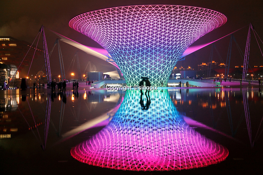 Visitors walk past illuminated funnel like structures of Sunshine Valley during the first day of the trail run for the 2010 World Expo in Shanghai, China..