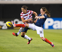 Ali Krieger (11) of the USWNT fights for the ball with Lisa Evans (16) of Scotland during the game at EverBank Field in Jacksonville, Florida.  The USWNT defeated Scotland, 4-1.